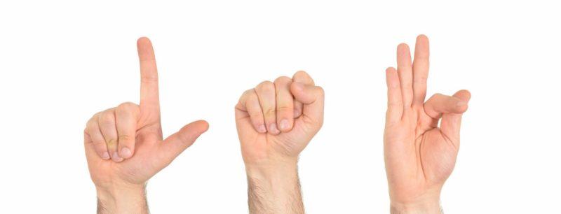 trois mains langue des signes